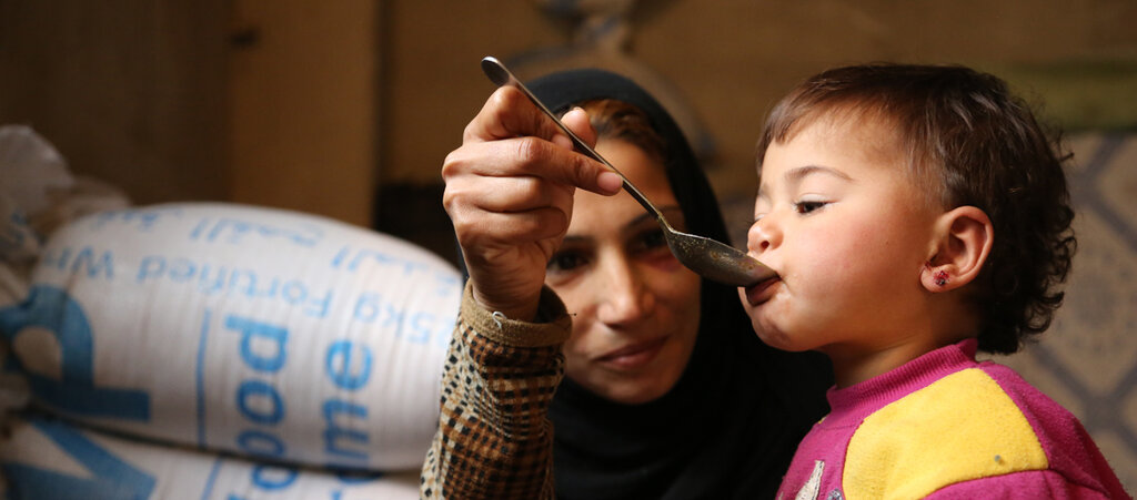Syrian mother feeding child