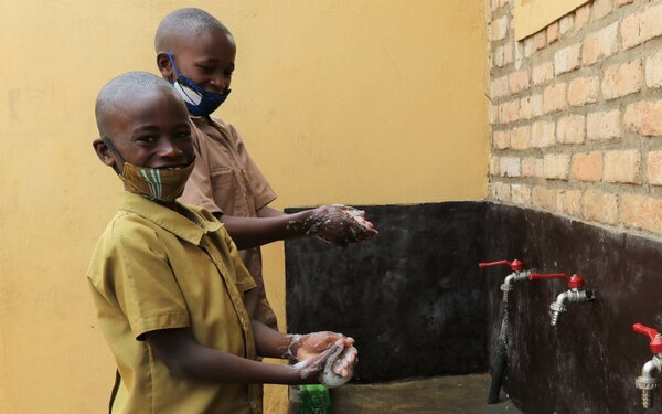 An efficient water supply means the children can wash their hands and the local community can access water closer to their homes. Photo: WFP/Emily Frendenberg